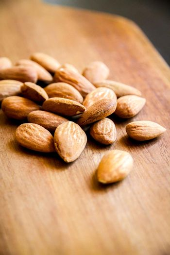 Almonds on a wooden cutting board