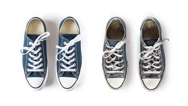 New and old blue sneakers isolated on white background