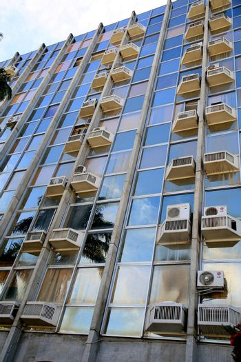 air conditioners on commercial building facade
