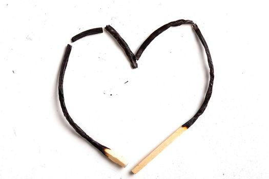 heart shaped matchsticks, burned