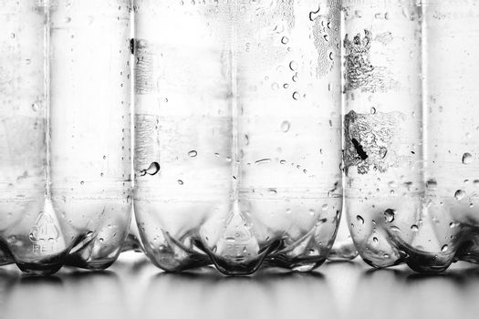 plastic bottles with condensation droplets abstract