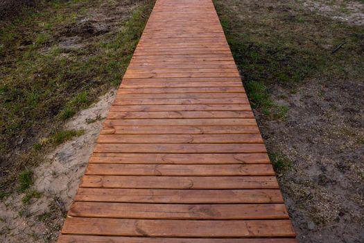 Wooden boardwalk walking path in the yard.