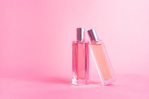 Perfume bottles on a pink background . Aromatherapy. The scent of perfume. The choice of fragrance. Pink background.