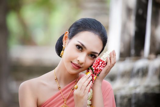 Beautiful woman, Thai national costume, traditional Thai dress, Thai woman, good mood, beautiful smile background - Image with noise and grain