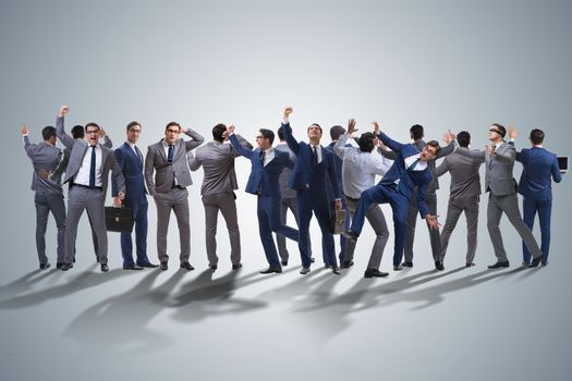 Many business people in cooperation concept