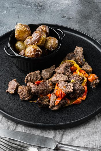 Beef stew goulash - rustic style, on gray stone background