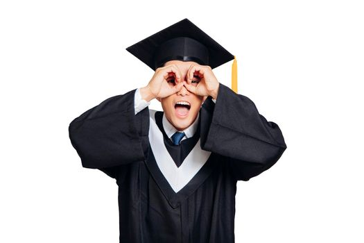 Male graduation  eye looking through hands with happy face