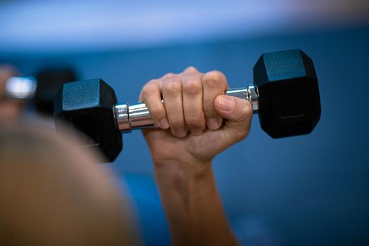Woman with a Dumbbells