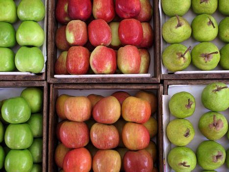 Fresh apples and pears on grocery store