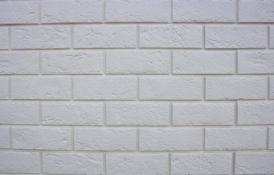 Abstract texture , white brick wall background, rough masonry blocks, architectural wallpaper.