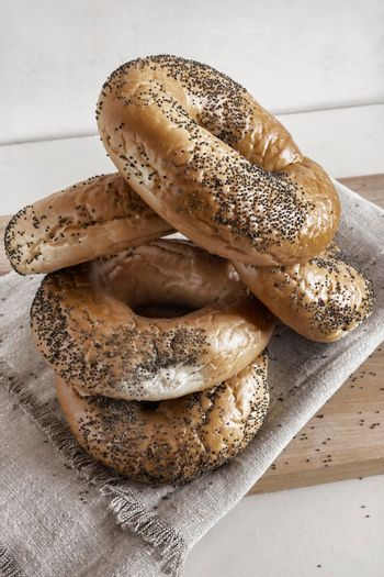 Bagels with poppy seeds on a napkin