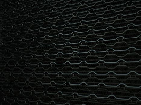Vehicle radiator grille closeup background texture