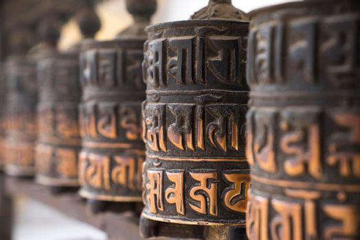 Buddhist prayer wheels in row
