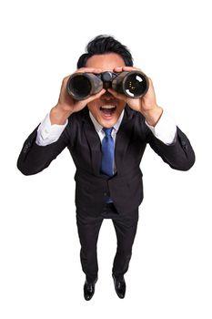 Surprised Young businessman  looking  through binoculars