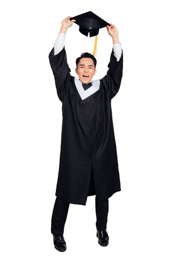 Full length of Excited young male graduation