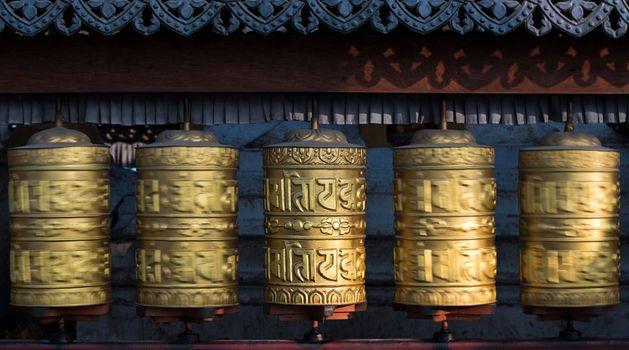Buddhist prayer wheels rotating in motion