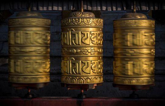 Buddhist shiny prayer wheels in motion