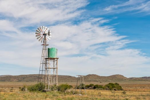 Water-pumping windmill and water tank on farm near Hanover