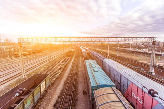 Commodity cars on the railway. Cargo transportation. Panorama of wagons awaiting loading. Russian railway. Russia, Tosno, April 20, 2020