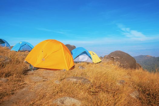 Set up a tent on the hill Full of grasslands