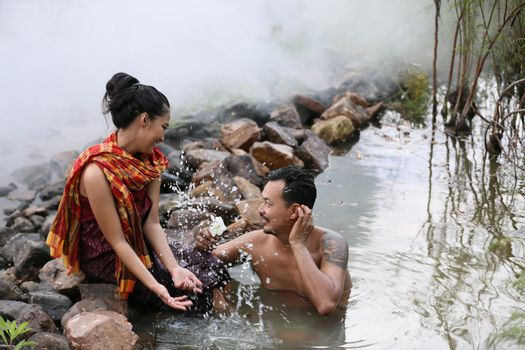 Thailand Couple love enjoy in bathing together in the river against rural background. this is life of young man and young girl couple in Countryside Thai South East Asia.