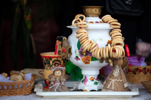 Belarus, the city of Gomil, February 24, 2020. Maslenitsa holiday.Russian samovar and a lot of bagels. Symbols of Russia.