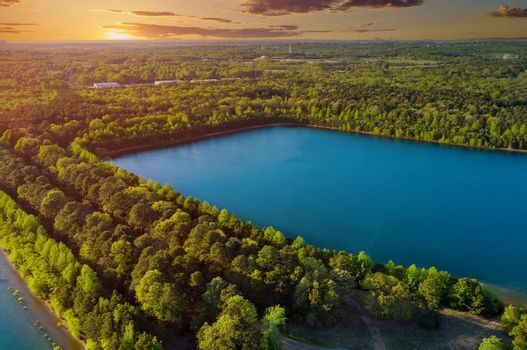 Fantastic summer lake panorama aerial view of a between the over trees forest