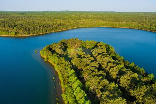 Aerial view of natural pond on a sunny summer day forest panorama