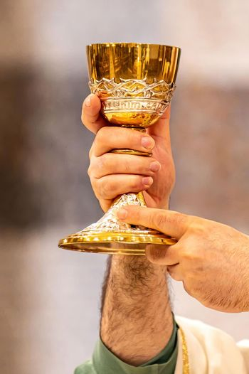 chalice of wine during the eucharistic rite of the holy mass