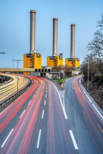 Highway and  power station at dusk