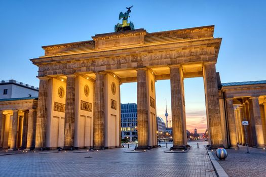 The Brandenburg Gate with the TV Tower in the back before sunrise