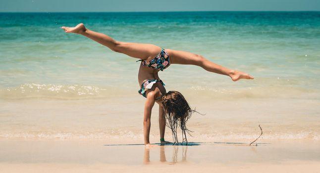 Little Girl Athlete on the Beach