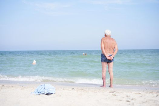 Alone unrecognizable senior man standing sea beach Sadness loneliness ageing solitude aged