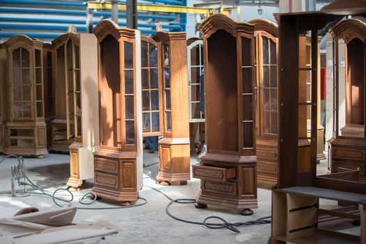 Furniture manufacture from a natural tree.Furniture manufacture. Factory for the manufacture of expensive furniture. To do cabinets. Wood processing in furniture