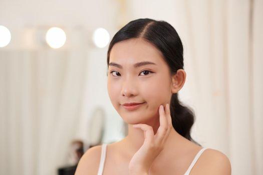 Happy pretty woman enjoy healthy soft moisturized hydrated skin, facial skincare rejuvenation moisture spa everyday treatment concept
