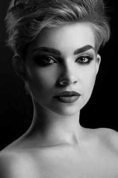 Monochrome close up of a beautiful woman wearing professional makeup