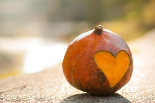 Pumpkin with carved heart on it