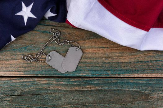 Waving American flag and military ID tags for Memorial Day, Labor Day and 4th of July holiday concepts