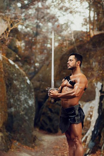 Manly warrior at the mountains