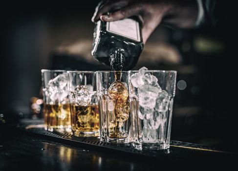 Barman pouring alcoholic drink