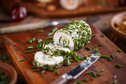 Soft cheeses rolled in chives
