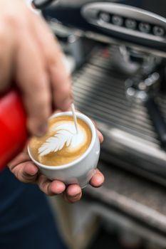 Barista creating latte art