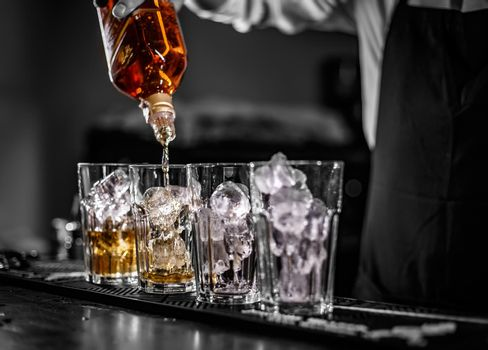 Barman pouring alcoholic drin