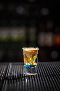 Brain cocktail in a shot glass