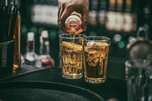 Bartender pours alcoholic drink