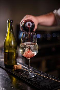 Bartender prepares an alcoholic cocktail
