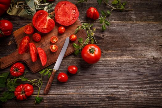 Flat lay composition with juicy tomatoes