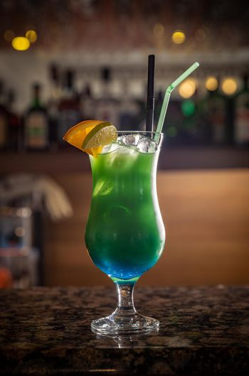Glass of green alcoholic cocktail