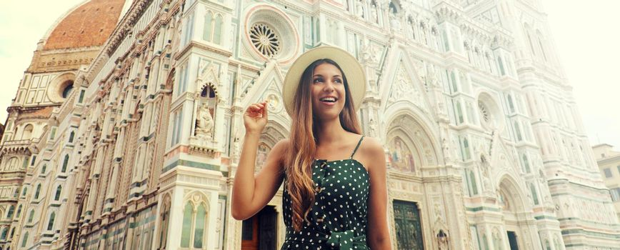 Portrait of beautiful tourist woman in Florence with the Cathedral on the background. Traveler girl in Italy with Florence landmark. Vintage filter.