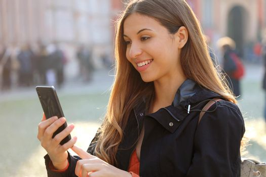 Woman with smartphone outdoor